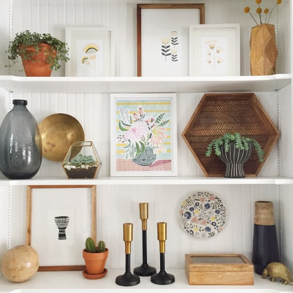 These shelves are perfect. Pretty art, and love that hexagon tray and all the wood and gold tones.
