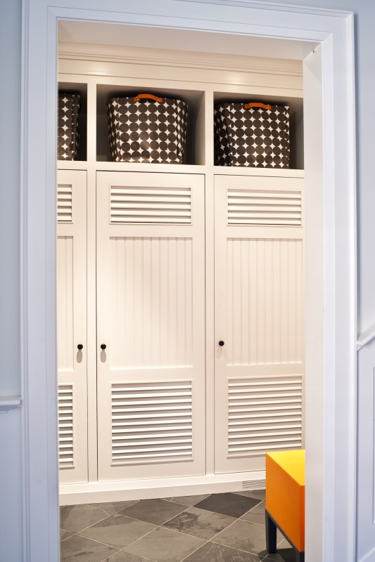 mudroom lockers with doors, baskets above. so much storage! | 100+ Beautiful Mudrooms and Entryways at Remodelaholic.com