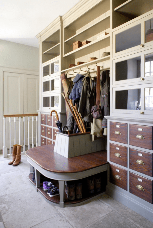 bootroom entry, the bumpout with the bench and storage for umbrellas in the middle is pretty sweet | 100+ Beautiful Mudrooms and Entryways at Remodelaholic.com