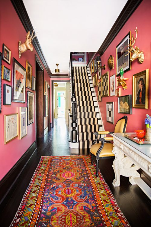 bold entryway, not sure I could to this pink but I love the black trim | 100+ Beautiful Mudrooms and Entryways at Remodelaholic.com