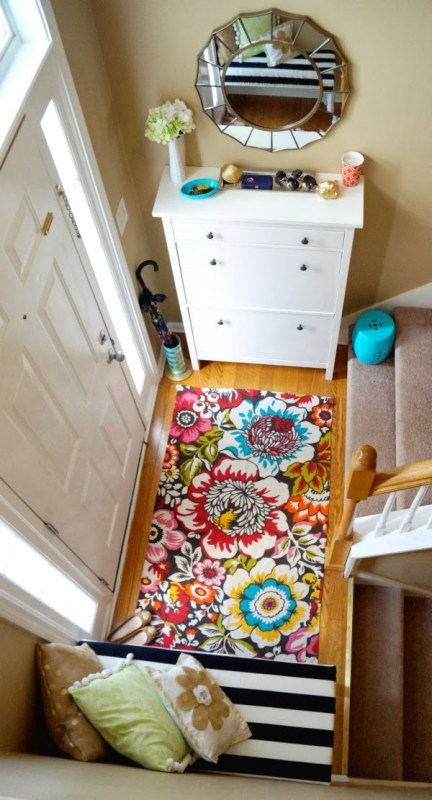 bright colored small entry foyer in a split entry with shoe storage | 100+ Beautiful Mudrooms and Entryways at Remodelaholic.com