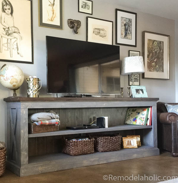 This farmhouse TV console is perfect for storing your electronics, or use it in the dining room as a sideboard to hold serving dishes and decor. Designed by The Gritty Porch with building plans by Remodelaholic.