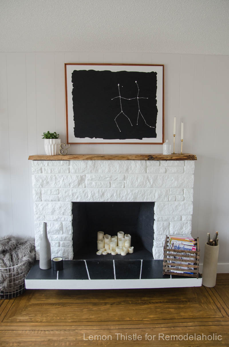 Updated stone fireplace with a diy live edge wood mantel. Beautiful!