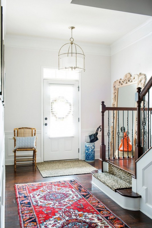 cheerful traditional entryway | 100+ Beautiful Mudrooms and Entryways at Remodelaholic.com