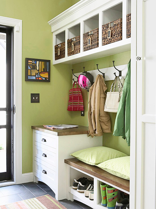 This green mudroom is perfect. Built-in storage for shoes, plus drawers and hooks and cubbies overhead. | 100+ Beautiful Mudrooms and Entryways at Remodelaholic.com