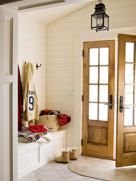 Neutral foyer, shiplap, bench, and wood doors. Can it get any better?   100+ Beautiful Mudrooms and Entryways at Remodelaholic.com