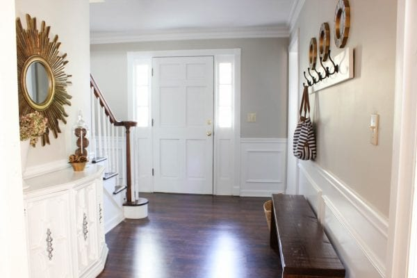 neutral gold entryway | 100+ Beautiful Mudrooms and Entryways at Remodelaholic.com