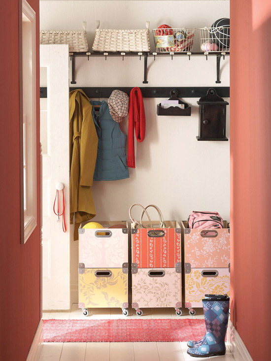 Red mudroom with rolling storage crates and shaker peg coat hooks. Love the patterned boxes! | 100+ Beautiful Mudrooms and Entryways at Remodelaholic.com