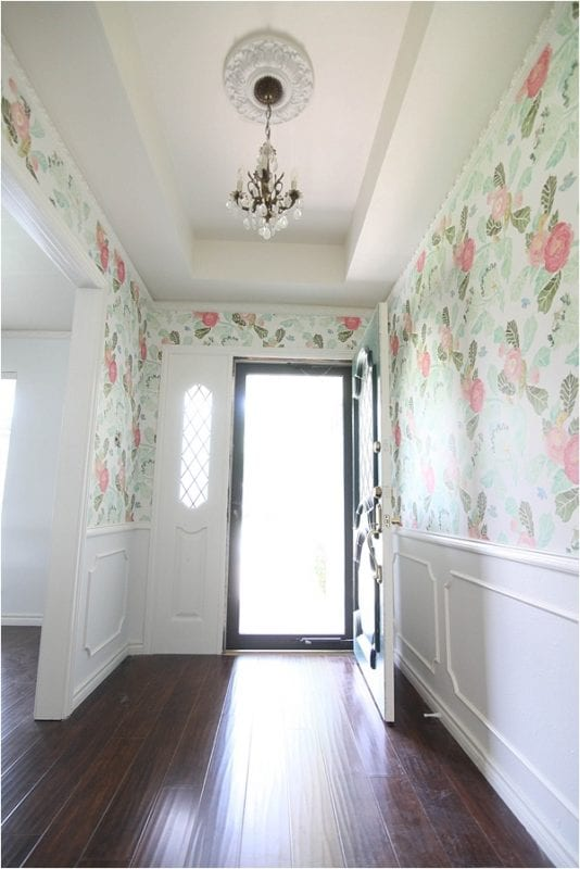 This wallpaper is AMAZING! Looks great with the wood floors and classic white wainscoting in the entry | 100+ Beautiful Mudrooms and Entryways at Remodelaholic.com