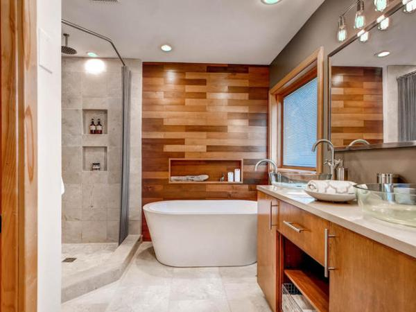 Beautiful bathroom renovation with DIY wood plank wall