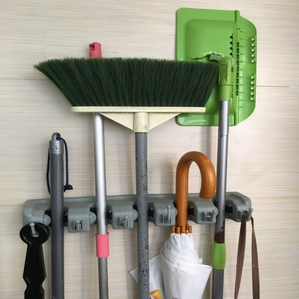 Organize mops and brooms inside, or shovels, rakes, and tools outside!