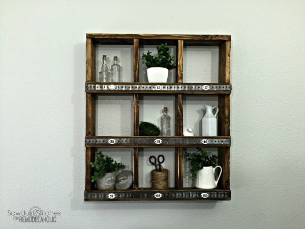 These rustic wood and metal cubbies are versatile for decor and organizing, and you can make your own DIY wall cubby shelf for around $12 with this easy tutorial! Great for beginners and first-time builders.