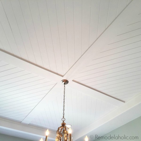 beautiful diagonal planked shiplap ceiling design via Remodelaholic