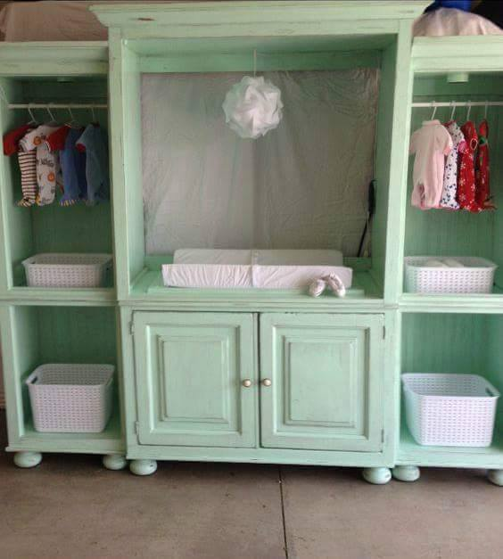 turn an old entertainment center into a changing station for the nursery