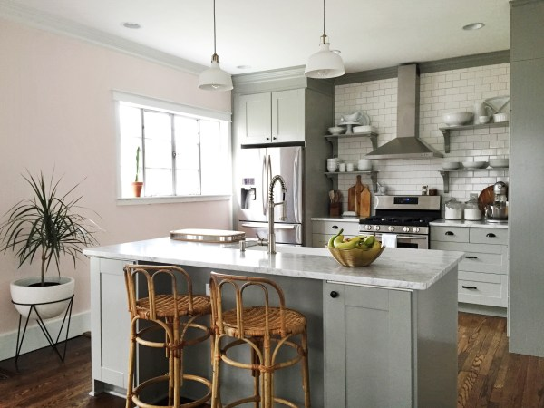 Beautiful gray and white neutral kitchen, white subway tile with IKEA cabinets and open shelving