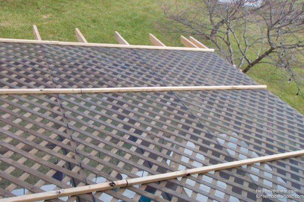 Top view of DIY pergola with lattice and screen, tutorial from The Heathered Nest on Remodelaholic.com.