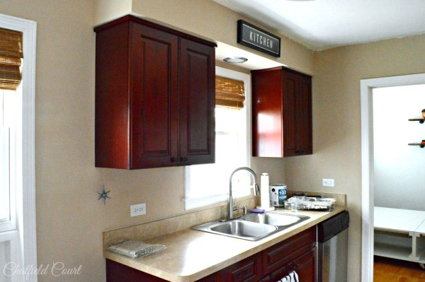 DIY kitchen remodel, dark to white, by Chatfield Court featured on @Remodelaholic