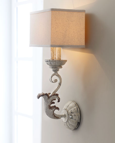Wall sconce and vintage doors make amazing bedside lighting, by Simple Nature Decor featured on @Remodelaholic