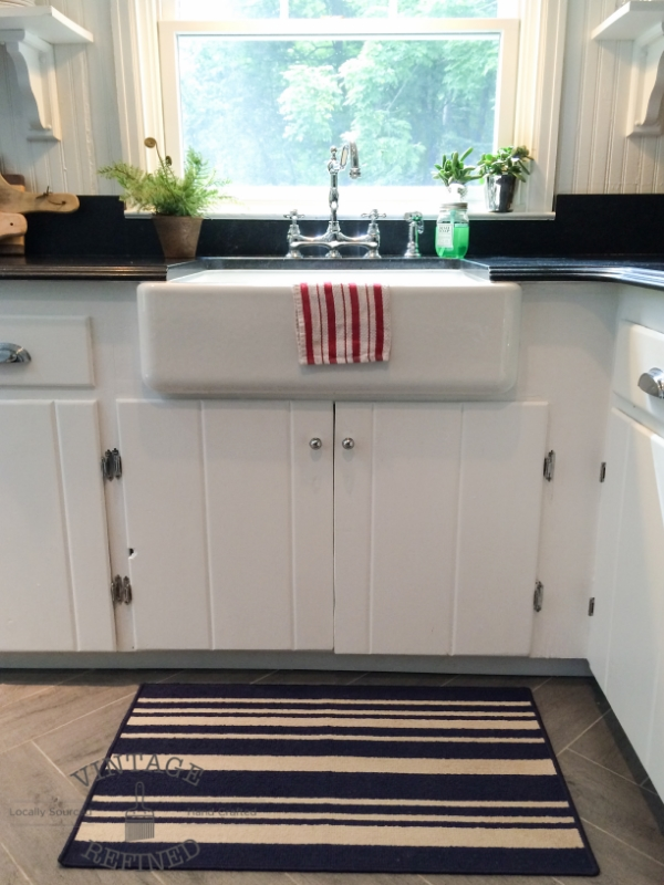 Farmhouse sink in white and black kitchen, by Vintage Refined featured on @Remodelaholic