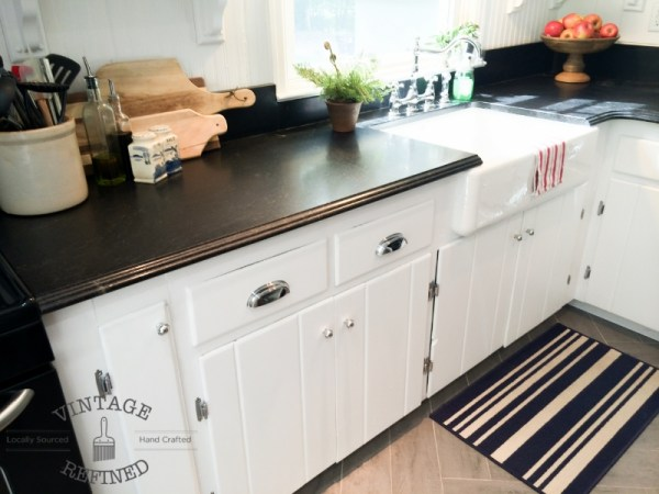Dark granite countertops in white kitchen makeover, by Vintage Refined featured on @Remodelaholic