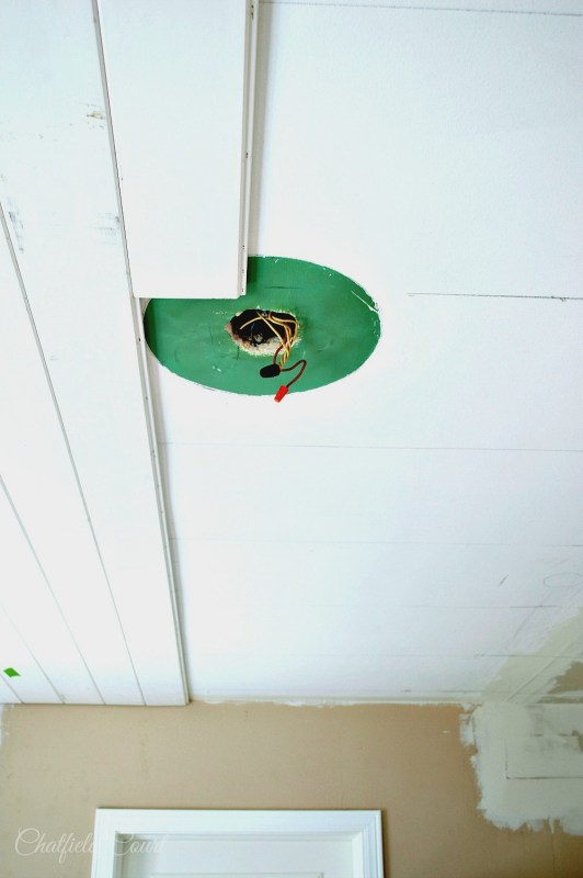 DIY Plank board ceiling, work around a light fixture, by Chatfield Court featured on @Remodelaholic