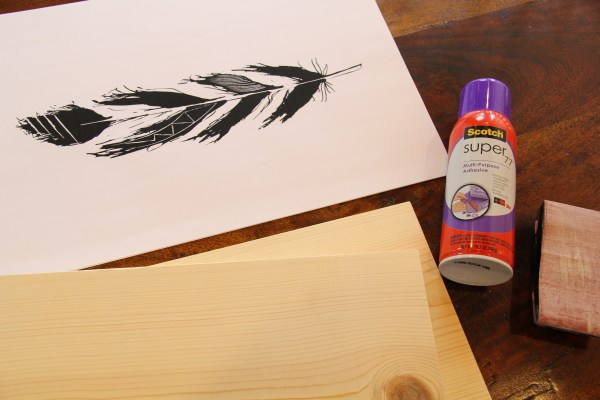 DIY hand-drawn feather prints mounted on wood @Remodelaholic