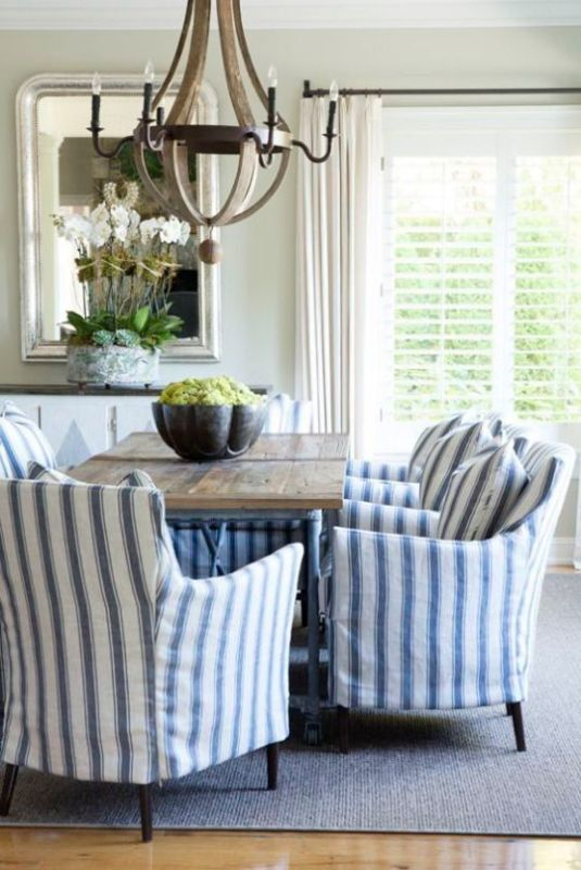 farmhouse dining room with striped chairs and industrial table via My Decor Chic