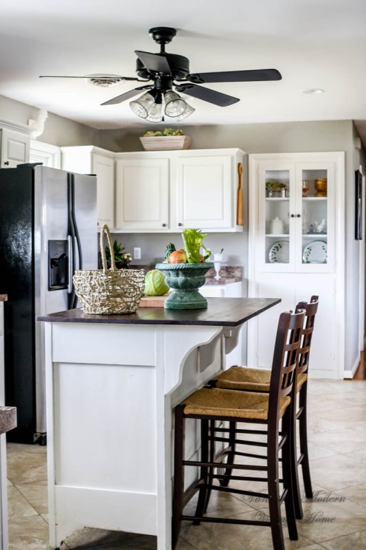 Wood to white kitchen tutorial, no removing cabinet doors! by Vanessa's Modern Vintage Home featured on @Remodelaholic