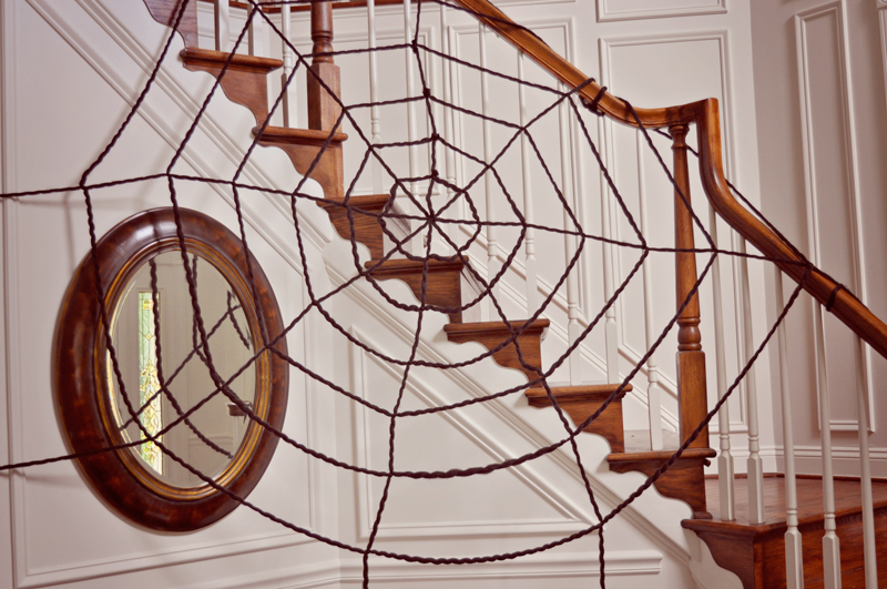 How to make an extra large spider web | Easy DIY decor for a Halloween party: an oversized yarn spiderweb, so easy to make but such a big impact! | Simple Halloween Decor Ideas and Tutorials at Remodelaholic.com
