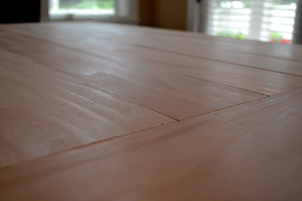 DIY planked table top for existing table by Rachel Teodoro at Holy Craft featured on @Remodelaholic