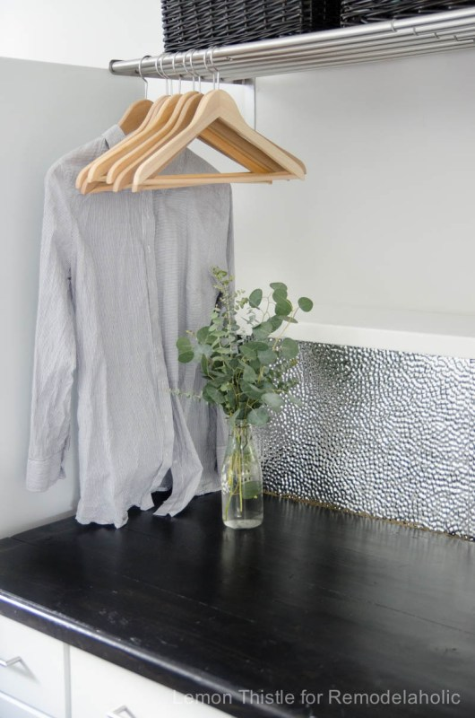 Learn how to install a unique and modern (but easy to clean!) metal ceiling tile backsplash. Tip #1: It's all about using the right adhesive!