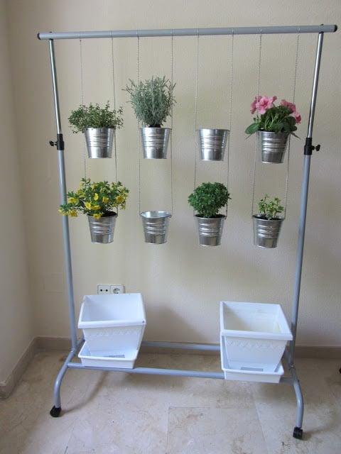 vertical hanging garden pots with a portable closet and inexpensive metal bucket planters from IKEA via millaveallen