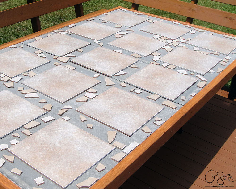DIY Tiled Table Top With Mosaic Borders By Q Schmitz Featured On  @Remodelaholic