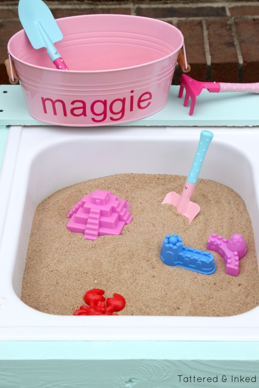 Make your own water and sand table for your toddler by Tattered and Inked featured on @Remodelaholic