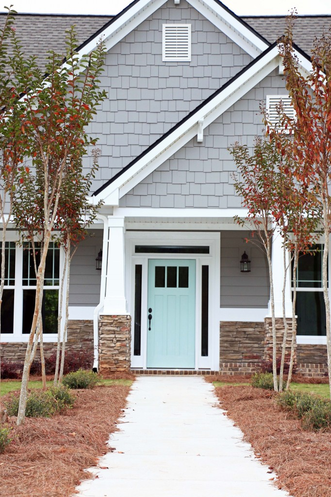 Exterior Paint Colors that Increase Curb Appeal | Exterior color is SW Dovetail and door color is SW Waterscape | More info on Remodelaholic.com