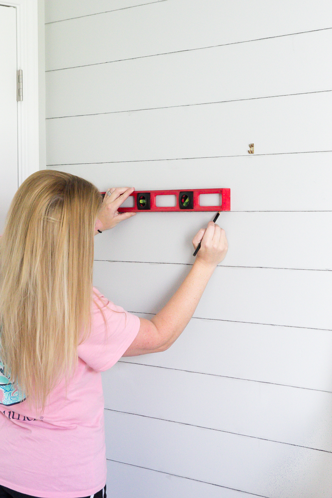 How to Shiplap a Wall for Free | Bless'er House for Remodelaholic.com - A quick and easy tutorial on how to shiplap a wall for free using just two standard toolbox items. No hard labor, no damage, and no commitment needed.