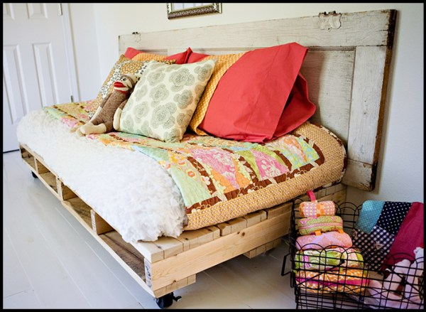 pallet bed and 15 awesome pallet furniture ideas featured on remodelaholic.com