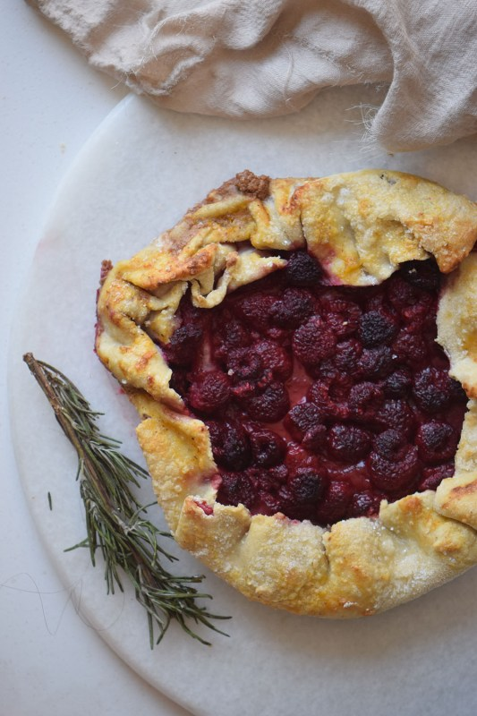Looking for a simple pie like dessert recipe to try? This raspberry galette is the perfect dessert to share via remodelaholic.com