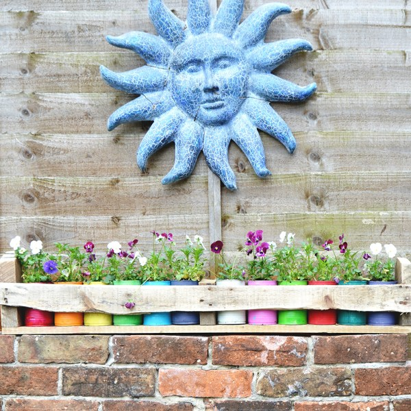 colorful-tin-can-planter-pillar-box-blue
