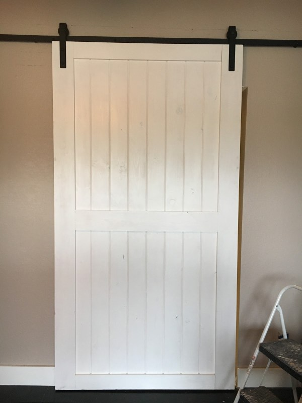 diy-sliding-door-using-hardware-found-on-ebay-over-inspired-featured-on-remodelaholic