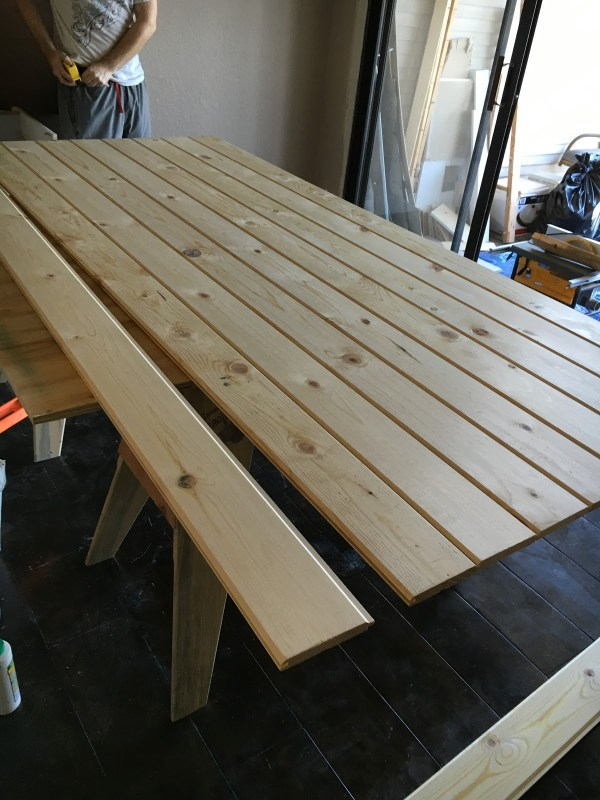 tutorial-for-building-the-cheapest-and-easiest-sliding-barn-door-tongue-and-groove-lumber-over-inspired-featured-on-remodelaholic