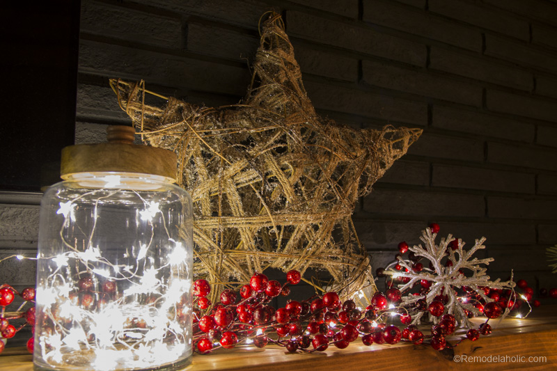 Looking to decorate your mantel for Christmas, but aren't sure where to start? Try these tips for creating a whimsical and rustic Christmas Mantel featured on Remodelaholic.com