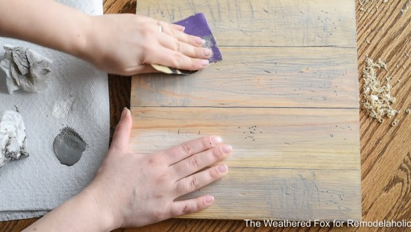 Tutorial On How To Make New Wood Look Old. How To Create Farmhouse Style Wall Baskets With Dollar Store Items. Get This Tutorial From The Weathered Fox On Remodelaholic!