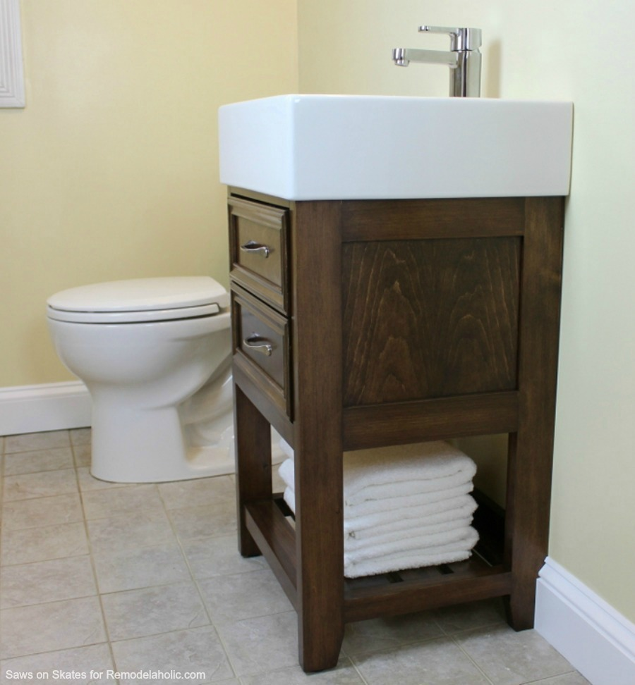 Build a small vanity with an IKEA sink -- and it has both open storage on the bottom AND a hidden storage cabinet behind two false drawer fronts.