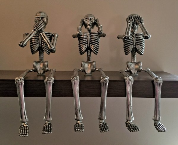 Easy DIY Halloween Decorations: DIY Painted Dollar Store Skeleton Decor, Remodelaholic