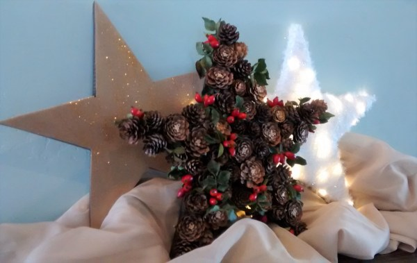 How to build 3 wooden Christmas stars from just ONE board, for about $12. These decorative wood stars are great for decorating for the Fourth of July and year round, too! | One board project | Christmas stars | Easy DIY building projects