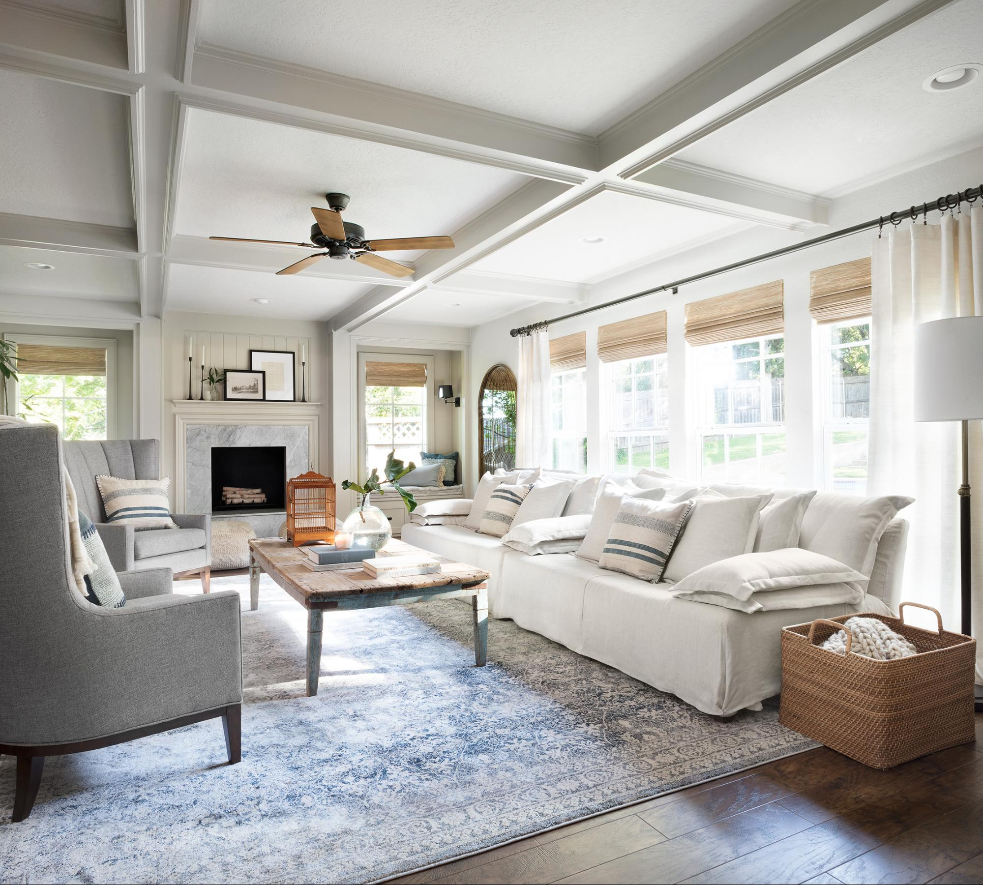 Fixer Upper Mountain House Living Room using neutrals and blue tones to create a modern traditional family room!