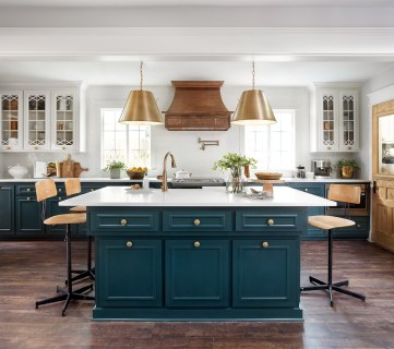 Fixer Upper Plain Jane House Kitchen. Love the white cabinets with the peacock blue island and gold pendants.