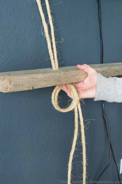 DIY reclaimed wood floating rope shelf tutorial | How to tie easy hanging rope shelves for decor and electronics #remodelaholic