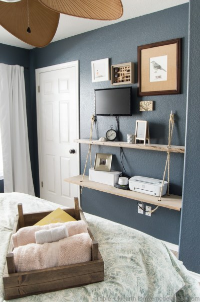 Guest room shelving and storage idea | DIY reclaimed wood floating rope shelf tutorial | How to make an easy hanging rope shelves for decor and electronics #remodelaholic